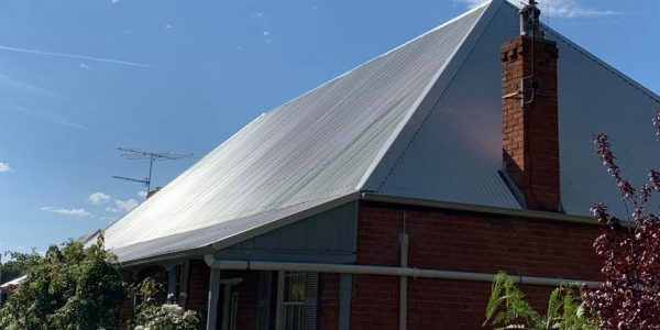new reroof in Stratco's Surfmist Colourbond roofing's sheets with Dune Quad Gutters
